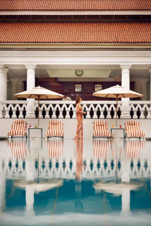 The outdoor swimming pool oasis at Raffles Singapore