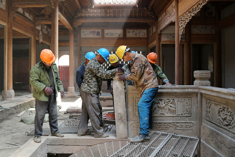 RS3211_9. master craftsmen reconstructing ming dynsaty stonework.jpg