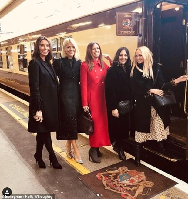 Left Christine Lampard, Holly Willoughby, Right, Emma Bunton boarding the Belmond British Pullman.jpg